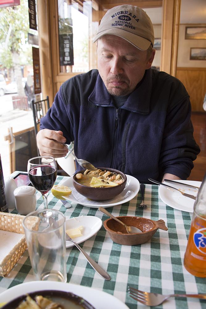 Karl enjoying Magellanic Seafood Soup in Puerto Natales